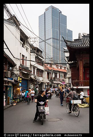 Old street and modern tower. Shanghai, China (color)