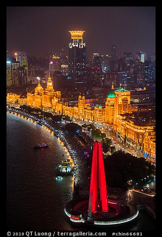 Peoples Memorial and illuminated Bund buildings at night from above. Shanghai, China (color)