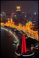 Peoples Memorial and illuminated Bund buildings at night from above. Shanghai, China ( color)
