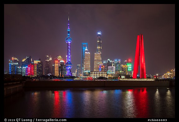 Peoples Memorial and city skyline at night. Shanghai, China (color)