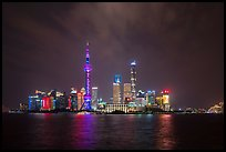 Shanghai skyline with Oriental Perl Tower and Huangpu River at night. Shanghai, China ( color)