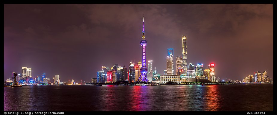 Shanghai city skyline from the Bund at night. Shanghai, China (color)