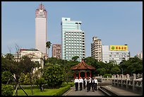 Office workers, 2-28 Peace Park, and high rises. Taipei, Taiwan (color)