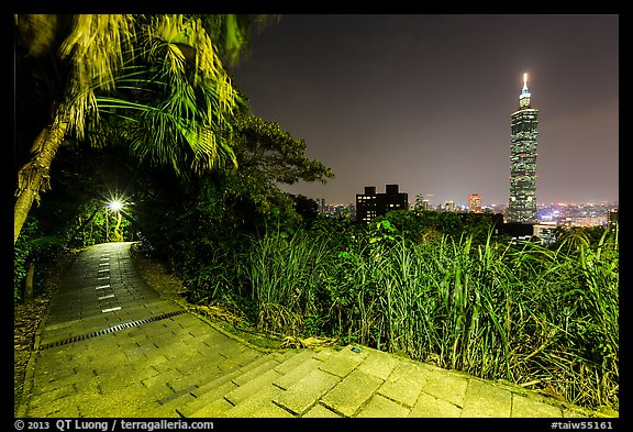 Path on Elephant Mountain with Taipei 101 in the distance at night. Taipei, Taiwan (color)