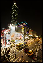 Shopping district street at night and Taipei 101. Taipei, Taiwan (color)