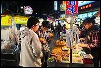 Customer buying foods at Shilin Night Market. Taipei, Taiwan (color)