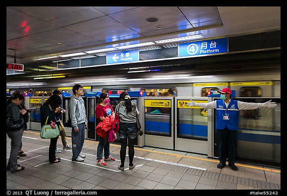 Subway with staff directing passengers. Taipei, Taiwan (color)