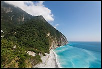 Lush mountains drop into azure ocean. Taroko National Park, Taiwan ( color)