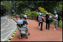 Tourists wearing park-provided helmets for safety. Taroko National Park, Taiwan ( color)