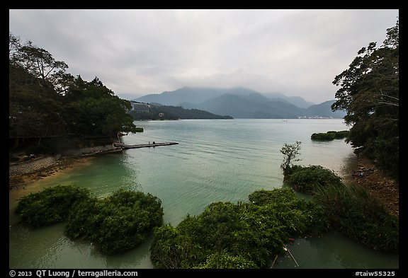Cove with floating rafts on which plants are being grown. Sun Moon Lake, Taiwan (color)
