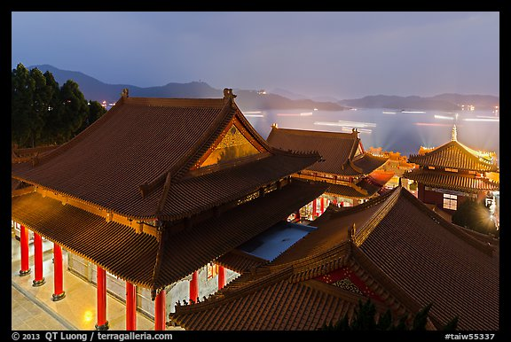 Wen Wu temple at night with light trails from boats. Sun Moon Lake, Taiwan (color)