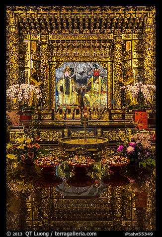 Offerings, altar and reflections, Wen Wu temple. Sun Moon Lake, Taiwan (color)