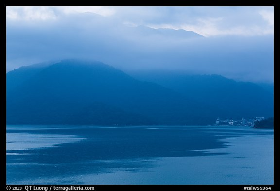 Itashao Village and cloud-shrounded mountains at dawn. Sun Moon Lake, Taiwan (color)