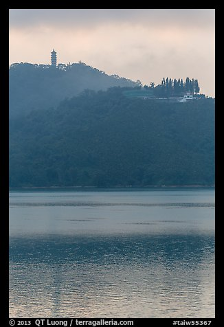 Syuanzang Temple and Tsen Pagoda in dawn mist. Sun Moon Lake, Taiwan (color)