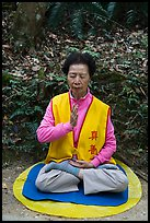Woman meditating. Sun Moon Lake, Taiwan ( color)