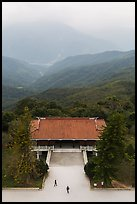 Two people, temple, and misty mountains, Tsen Pagoda. Sun Moon Lake, Taiwan ( color)