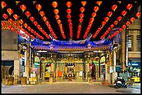 Temple and red paper lanterns at night. Lukang, Taiwan (color)