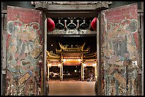 Painted doors, looking towards gate at night, Tienhou Temple. Lukang, Taiwan (color)
