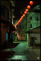 Red paper lanterns glowing in  Nine-turns lane at night. Lukang, Taiwan (color)