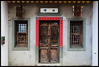 Facade of concrete building with wooden doors and windows. Lukang, Taiwan ( color)