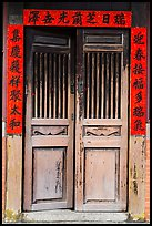 Wooden door with chinese script on red paper. Lukang, Taiwan ( color)