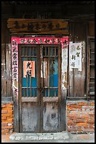 Door with weathered wood and inscriptions. Lukang, Taiwan ( color)