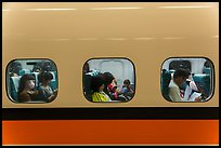 High speed rail car passengers seen through windows. Taiwan (color)