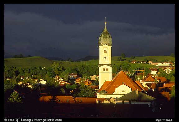 Nesselwang and St Andreas church, storm light. Bavaria, Germany
