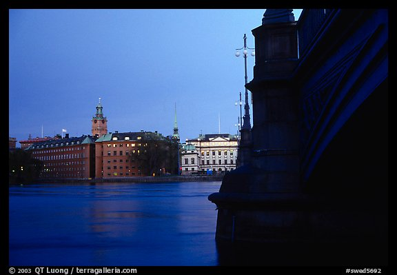Bridge on Riddarfjarden and Gamla Stan, midnight twilight. Stockholm, Sweden (color)