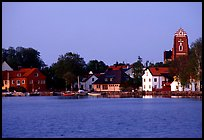 Houses, church, across the lake at dusk, Vadstena. Gotaland, Sweden ( color)