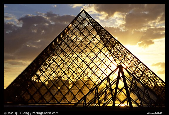 Sunset and clouds seen through Pyramid, the Louvre. Paris, France (color)