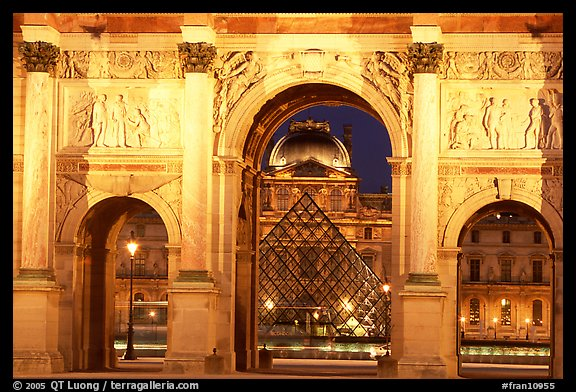 Arche de triomphe du Carousel, Louvre, and Pyramid at night. Paris, France