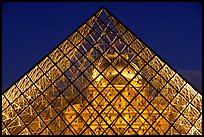 Louvre seen through pyramid at night. Paris, France (color)