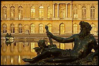 Statue, basin, and facade, late afternoon, Versailles Palace. France