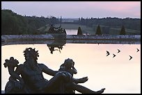 Sculptures, basin, and gardens at dusk, Palais de Versailles. France (color)