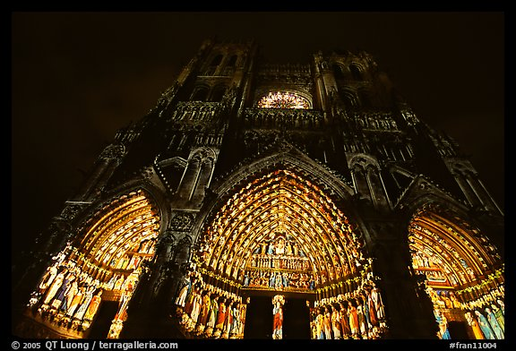 Looking up cathedral with doors laser-illuminated to recreate original colors, Amiens. France (color)