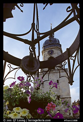 Flowers and clock tower,  Amiens. France