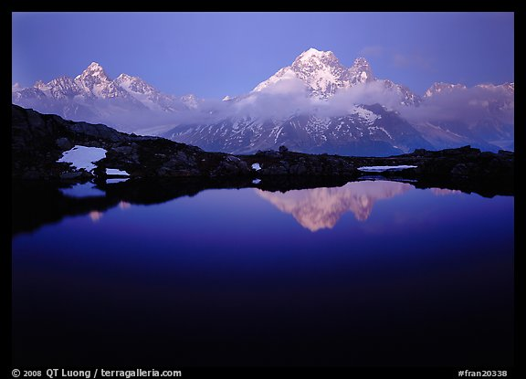 Aiguille Verte reflected in pond at dusk, Chamonix. France (color)