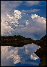 Mont Blanc and clouds reflected in pond, Chamonix. France