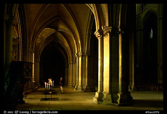 Worshiper inside the Saint-Etienne Cathedral. Bourges, Berry, France (color)