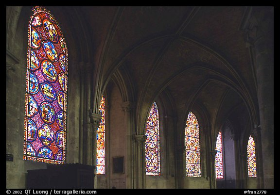 Aisle with tained glass windows, Saint-Etienne Cathedral. Bourges, Berry, France (color)