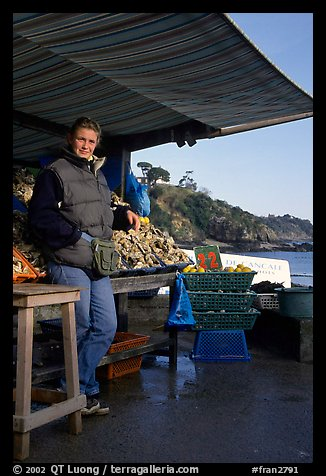 Oyster stand and vendor in Cancale. Brittany, France (color)