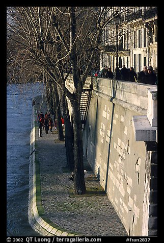 Walking on the banks of the Seine on the Saint-Louis island. Paris, France (color)