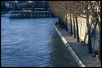 Walking on the banks of the Seine on the Saint-Louis island. Paris, France