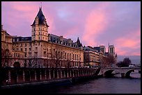 Conciergerie, Pont-au-change, and Ile de la Cite at sunset. Paris, France (color)