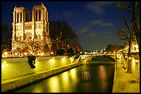 Facade of Notre Dame and Seine river at night. Paris, France ( color)