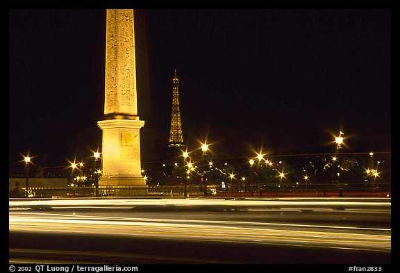 Car lights,  obelisk, and Eiffel Tower at night. Paris, France (color)