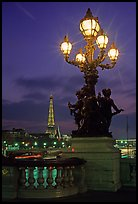 Lamps on Pont Alexandre III and Eiffel Tower at night. Paris, France