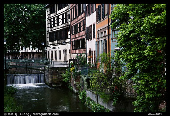 Half-timbered houses next to a canal. Strasbourg, Alsace, France (color)