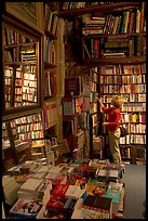 Picking-up a book in Shakespeare and Co bookstore. Quartier Latin, Paris, France